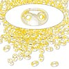 Seed bead, Preciosa Twin™, Czech glass, yellow-lined clear terra, 5x2.5mm oval with 2 holes. Sold per 10-gram pkg.